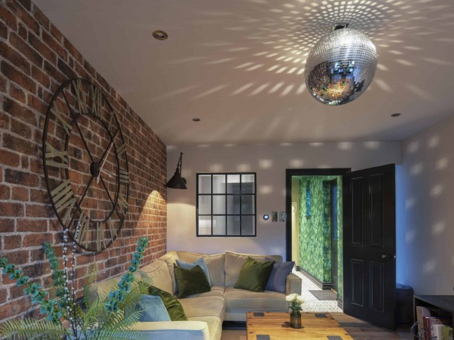 Chill out zone with feature brick wall | Beth Barker Designs